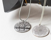 Resin Topped Necklace with a Cream Pastel Photographic Image of 'Tree Reflection' on this small Brass plated Pendant
