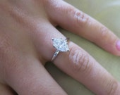 14K White gold single solitaire Marquise shape engagement ring.