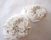 large milky white carved celluloid clip on earrings