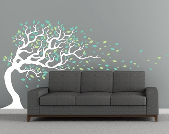 Windy tree wall decal living room decor. Large colorful tree decal sticker with flying leaves blowing in the wind.