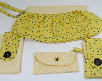 travel set, yellow and bee-print bag, sunglasses case, phone case and toiletry case
