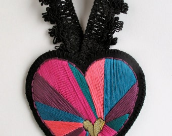 Embroidered heart ornament on black twill with emerald green pinks and purples geometric Christmas ornament Valentines Day decoration