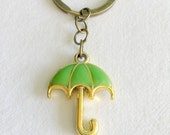 Green umbrella key chain with bronze colour split ring key ring jump rings and umbrella charm - weather rain raining raindrops rainbow