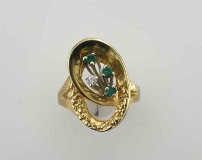 1970's 14 Karat Yellow Gold Swirl Emerald and Diamond Ring