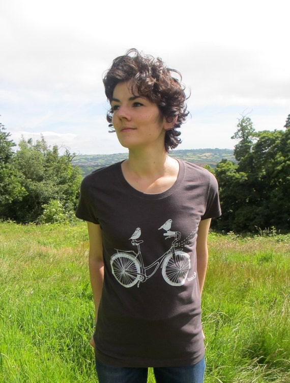 Organic Women's T-shirt hand screen printed with eco-friendly inks. Featuring two birds taking a ride on a bike.