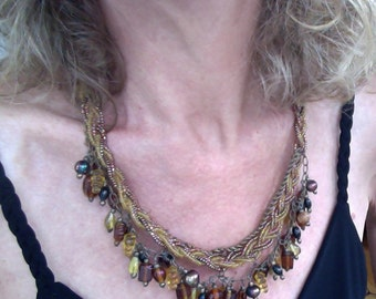 Golden, beaded, richly textured necklace