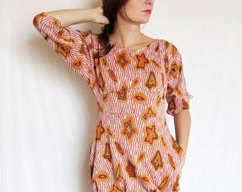 SALE Jersey tunic in yellow, red and orange African style pattern, 3 4 sleeve, with pockets. One of a kind, size small. Autumn tunic dress.