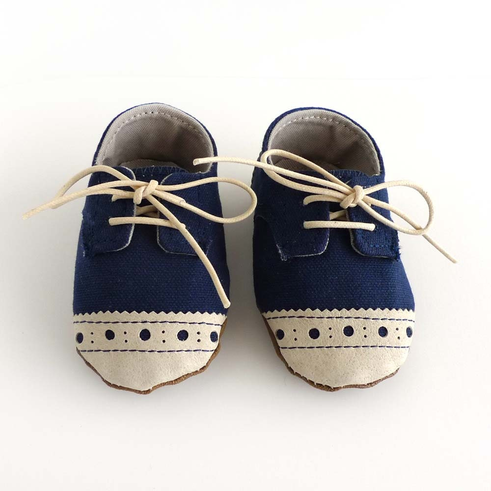 baby shoes boy or navy blue canvas with brogued beige