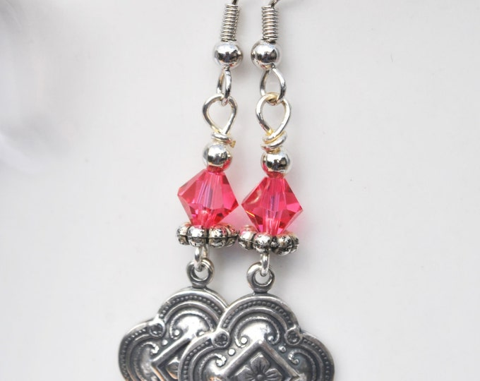 Fuschia Swarovski crystal earrings with carved floral silver tone drops
