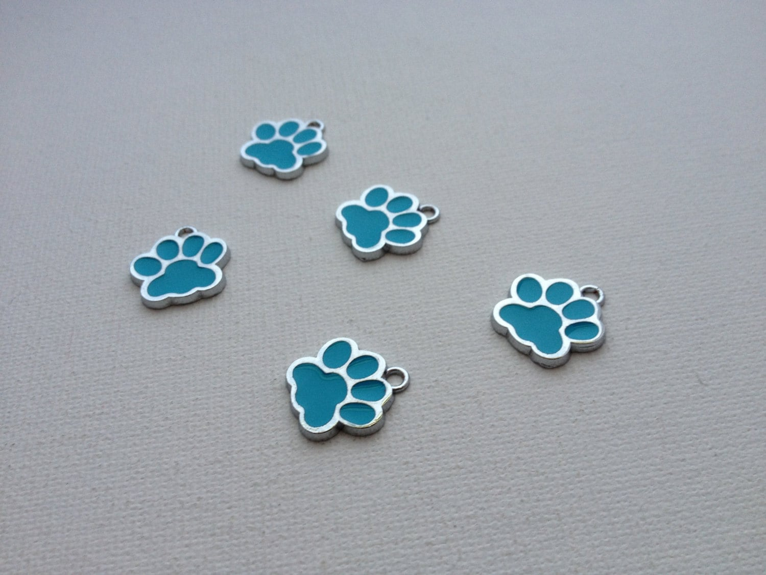 5 light blue enamel paw print charms by supplyinstyle on etsy