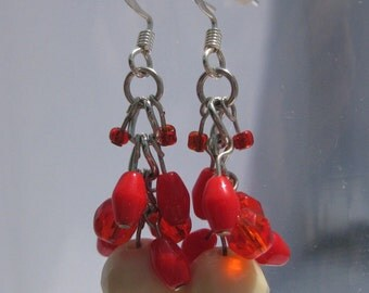Silver wire earrings: Ivory and coral colored beads