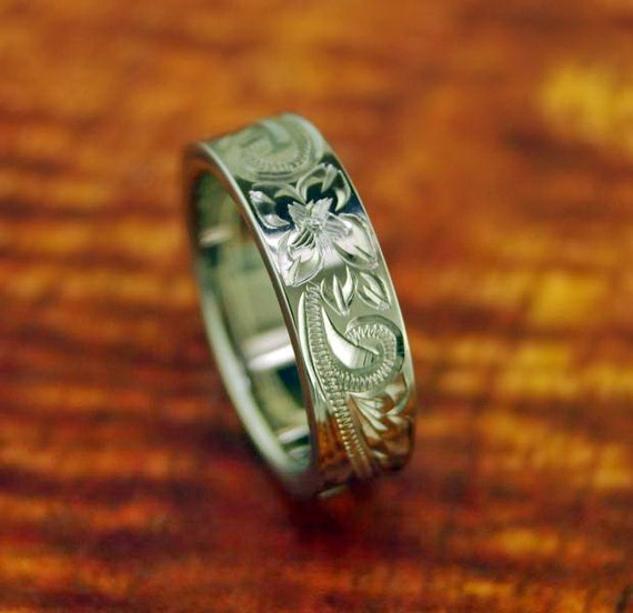 scroll titanium ring with hawaiian floral design by
