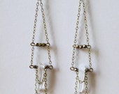 Long quartz crystal point earrings draped in antique brass chain with gold and brass faceted beads