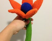 Danielle - Giant Crochet Flower with a deep blue mysterious centre surrounded by stunning orange petals with apple green stem