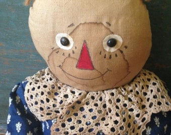 A folk art early Americana handmade doll from the late 80's early 90's Williamsburg Folk Art Show