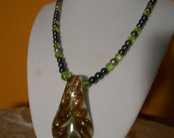 Gold and Limegreen lampwork and glass beads and hematite necklace