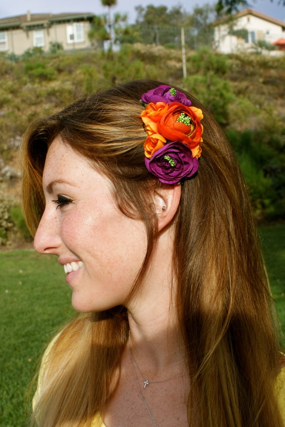 Purple and orange floral clusters with accents of green pips, hair accessory