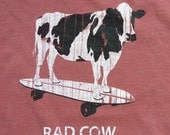 Clearance sale. 30% off. Adult large Rad Cow T shirt. Skateboarding cow, Red Rock color, quality pigment dyed 5.6 oz. Ringer T shirt.
