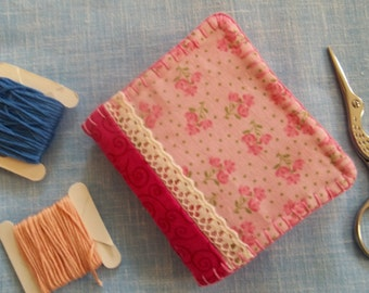 Needle book, pink floral print fabric.
