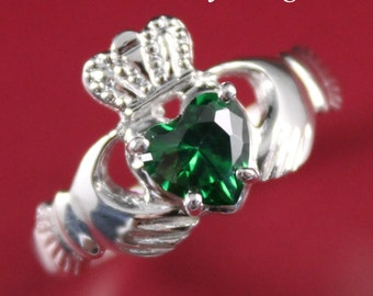 Claddagh ring, ladies silver claddagh ring, set with green stone.