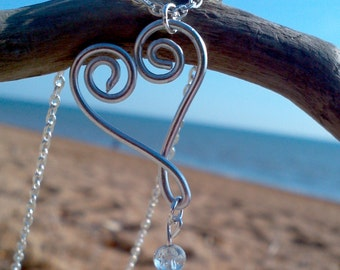 Silver swirl heart wirework necklace