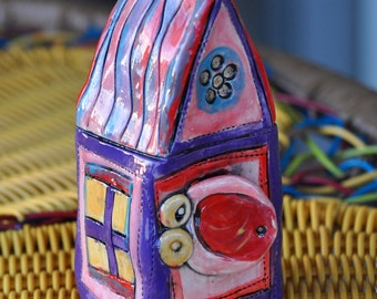 purple play house for birds or faeries