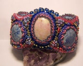 Southwest style gemstone wavy cuff bracelet in blues and pinks