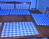 Three beautifull linen rectangle blue and white checked and blue and white alternating flowers placemats.  Dress up any table inside or out.