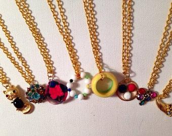Assorted vintage charm necklaces