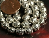 SALE Antique silver textured oval beads 7x6mm 14-inch strand (item ID YWAS3D3090)