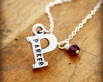 Name on initial necklace with birthstone color crystal bead. Sterling silver letter can be personalized with a date.