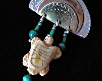 Turtle Rising .. A brooch of Sterling, Copper, Brass with Malachite and carved bone.