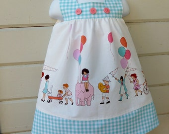 Girls Made to Order Dress in Sizes 1 through 6 Featuring On Parade Fabric by Sarah Jane