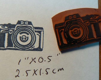 Camera Cling Mounted rubber stamp.
