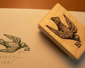 Pigeon carrying a letter rubber stamp.  P12