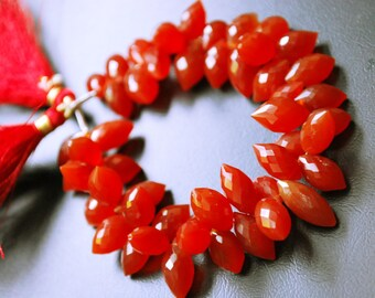 Amber red faceted dew drops