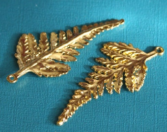 4 pcs of gold plated leaf pendant 62x28mm