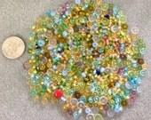 Various colors tiny saucer shaped glass beads