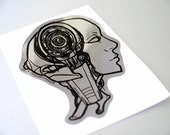Microfiction Zaps metallic silver and black robot art sticker