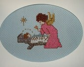 Completed Finished Cross Stitch Christmas Nativity Greeting Holiday Card ..A Watchful Angel looking over Baby Jesus in Manger ....