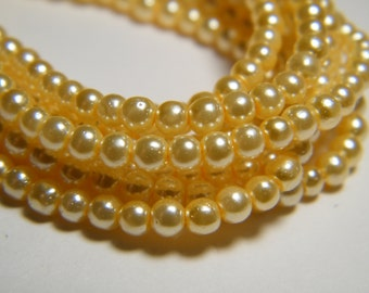 3mm round yellow glass pearls, strand aprox. 25 inches