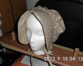 A bonnet wore by our early settlers.  Some call it the Civil War Bonnet or the Little House on the Prairie Bonnet.