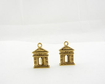 Two Gold-tone Pewter Museum Facade Charms
