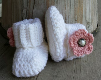 Crochet baby girl boots, in white with pink flower and pearl button center. size 0 to 3 mo.