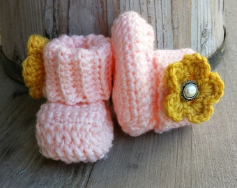 Crochet baby girl boots, in soft peach with honey flower and jewel button. size 0 to 3 mo. .