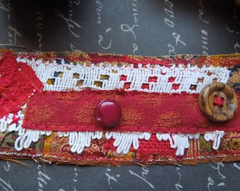 Red Textile Cuff with Red and Brown Buttons