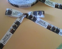 """7/8"""" Duck Dynasty White Background Camo Colored Figures Grosgrain Ribbon"""