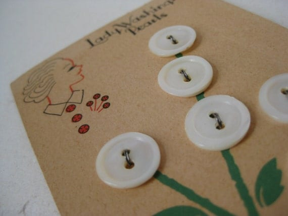 White buttons on vintage card