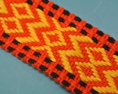 Vintage 1960s unused orangered/ yellow/ black woven cotton decoration band trim with abstract pattern for your sewing prodjects