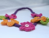 crochet flower necklace for little girls in fuchsia, orange and purple with buttons by yourmomdesigns